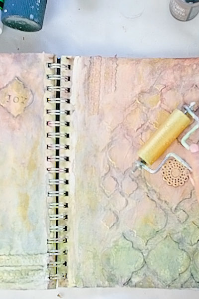 Art Journal 2 - Mixed Media Painting - applying golden paint with brayer